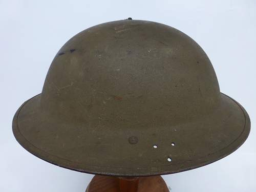 Click image for larger version.  Name:ww2britishhelmets 3005_1400x1050.jpg Views:11 Size:163.0 KB ID:505414