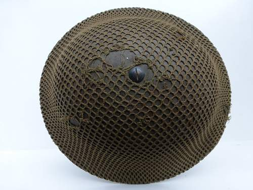 Click image for larger version.  Name:ww2britishhelmets 4278_1600x1200.jpg Views:51 Size:165.0 KB ID:639156