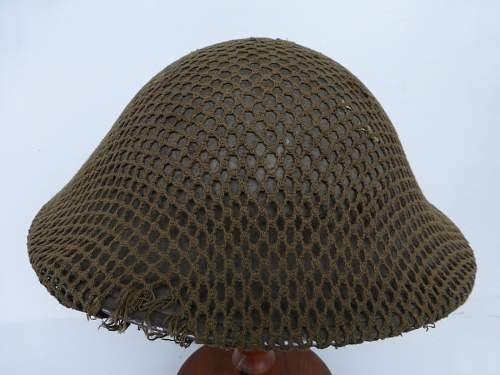 Click image for larger version.  Name:ww2britishhelmets 4270_1600x1200.jpg Views:39 Size:312.9 KB ID:640300