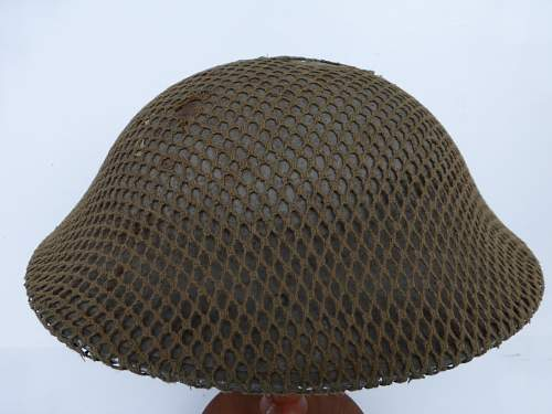Click image for larger version.  Name:ww2britishhelmets 4271_1600x1200.jpg Views:25 Size:139.6 KB ID:640301