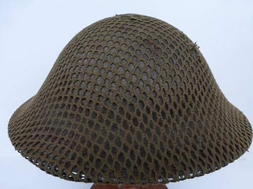 Click image for larger version.  Name:ww2britishhelmets 4272_1600x1200.jpg Views:29 Size:149.5 KB ID:640302