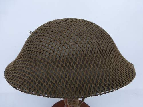 Click image for larger version.  Name:ww2britishhelmets 4273_1600x1200.jpg Views:13 Size:305.7 KB ID:640303