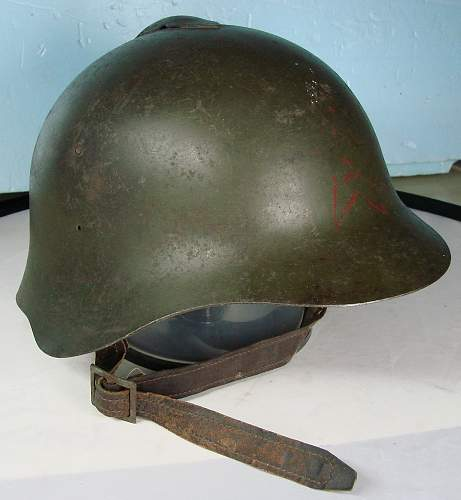 My small WWII helmet collection.