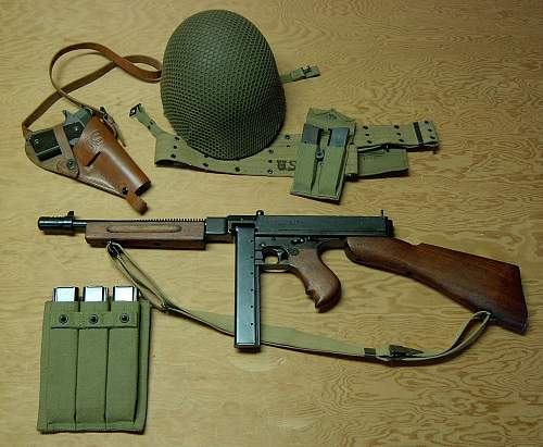 Click image for larger version.  Name:TSMG Grouping with 1911 helmet and pouches 017.jpg Views:12856 Size:246.8 KB ID:68250