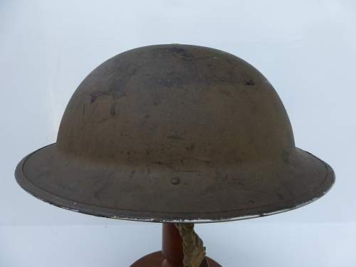Click image for larger version.  Name:ww2britishhelmets 4769_1600x1200.jpg Views:47 Size:195.3 KB ID:752267