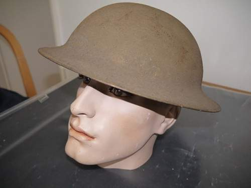 Help with a couple of WW1 Helmets.