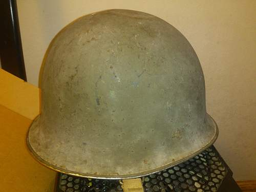 Greetings and a little help in identifying a helmet