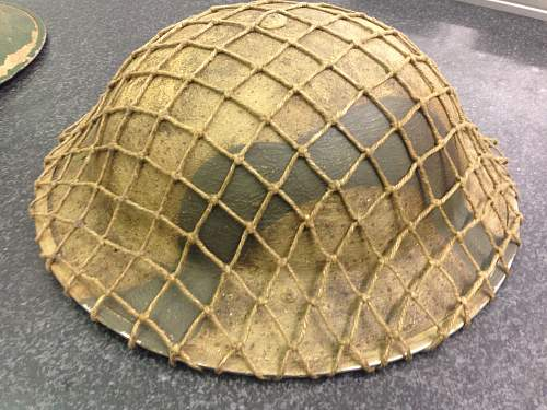 A couple of italy campaign helmets
