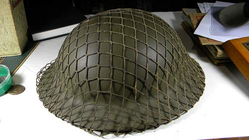 British Helmet with camo net.