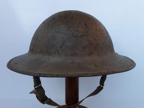 Strange Mark 2 Canadian helmet,,,,,any ideas.