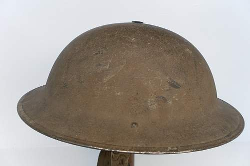 Click image for larger version.  Name:ww2britishhelmets 1231_1575x1050_1575x1050.jpg Views:28 Size:218.4 KB ID:882325