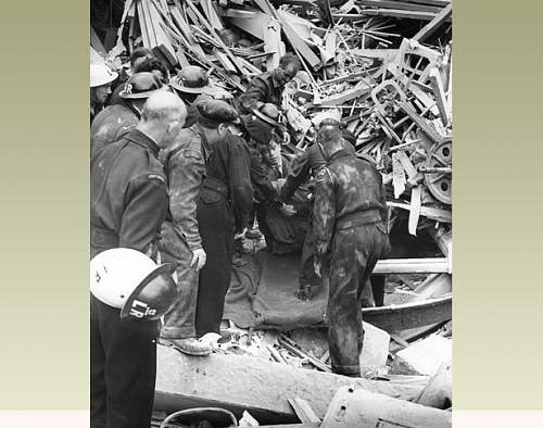 Click image for larger version.  Name:ww2_rescue_from_rubble.jpg Views:61 Size:98.9 KB ID:907410