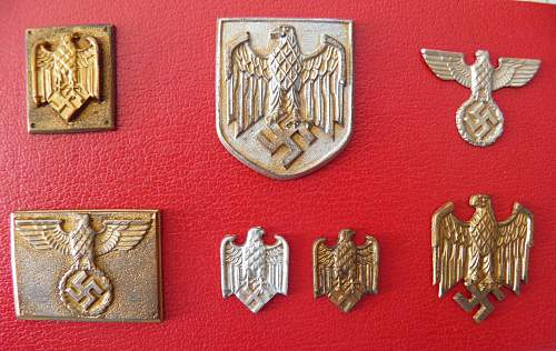 My collection of miniature aged wall eagles