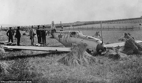 The charred remnants of Hitler's Luftwaffe: Rare photos reveals how British fields were littered with shot down German planes during the Battle of Britain