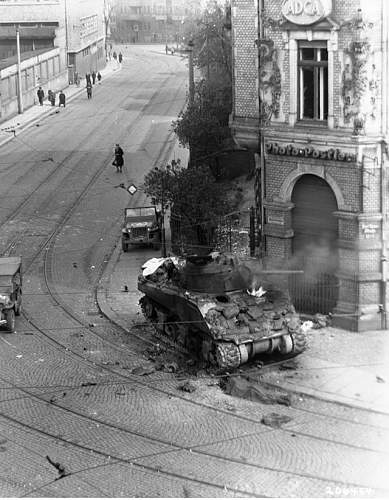 Click image for larger version.  Name:M4 tank of Sgt. George K. Cuthbert, Jr., Company C, 741st Tank Battalion, burns at the intersect.jpg Views:2152 Size:101.5 KB ID:798123