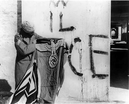 Click image for larger version.  Name:Sikh_soldier_with_captured_Swastika_flag.jpg Views:95 Size:44.0 KB ID:841132