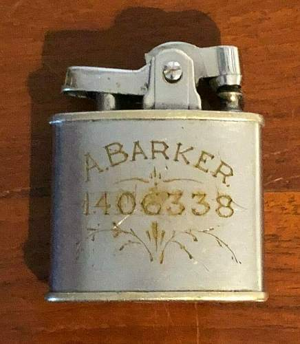 wristwatch and lighter . service numbers engraved.