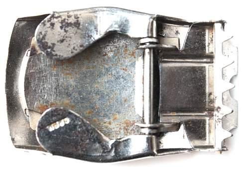 Early HJ belt buckle