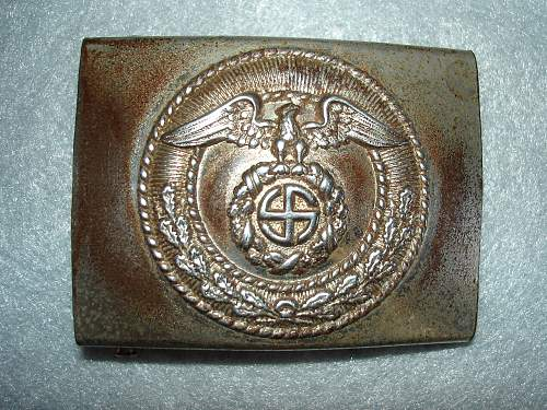 Please check this unmarked buckle for authenticity
