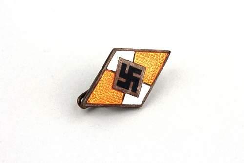 Unusual Yellow enamel HJ badge , is it legit?.