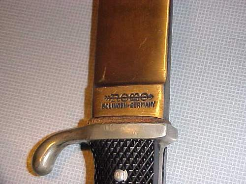 Is this a repro youth dagger?  ROMO?