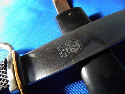 hj knife maker with deep motto?