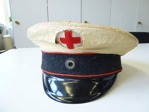 Click image for larger version.  Name:1Weltkrieg-Schirmmuetze-Freiwillige-Krankenpflege-mit-Wachstuchbezug.jpg Views:82 Size:78.3 KB ID:807451