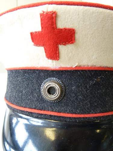 Click image for larger version.  Name:1Weltkrieg-Schirmmuetze-Freiwillige-Krankenpflege-mit-Wachstuchbezug_b14.jpg Views:47 Size:167.9 KB ID:807457