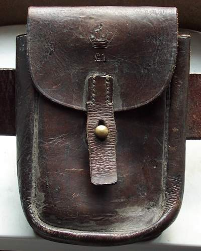 Crown stamped on leather pouch