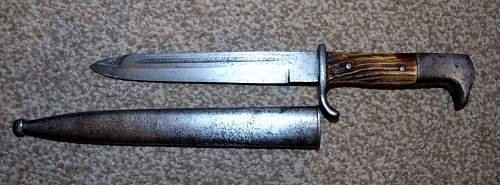 German dress bayonet. Is it converted, or just a poor example?