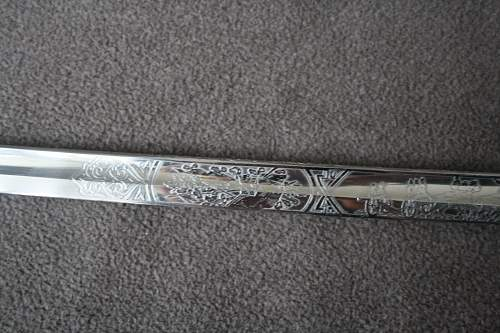 Info needed on German sabre with etching and blueing.