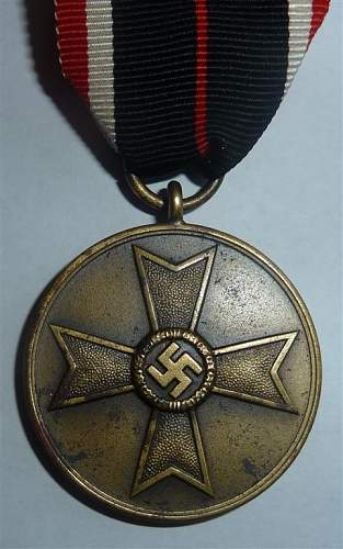 A Sturmabzeichen and 3 medals Fake or not?