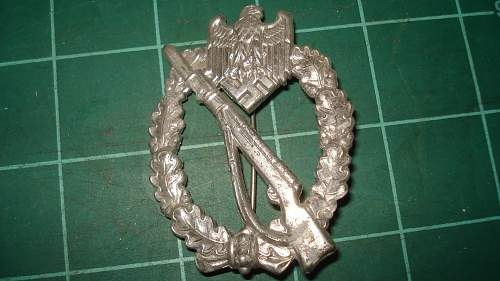 2 Infantry badges I got with the trade today, one silver one brown