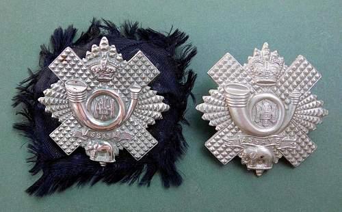 The Highland Light Infantry cap badges