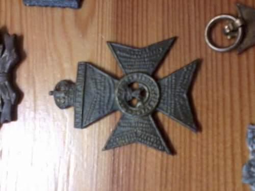 Help to id two badges