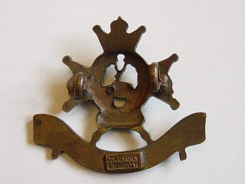 Click image for larger version.  Name:Sherwood Foresters Officer bronze cap badge reverese.jpg Views:166 Size:146.7 KB ID:61977