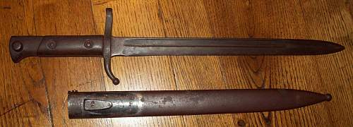 Thoughts on this Italian M91(?) Bayonet and Scabbard?