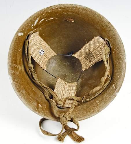 WW2 Japanese C.D helmet. Named. From Kobe.