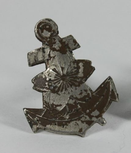 IJN Silver/nickel plated Helmet Anchor?  Seen one of these before ?