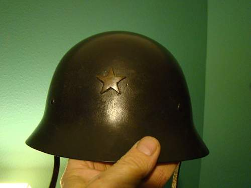is this a WWII Japanese helmet or Swedish M26 helmet made to look like one?