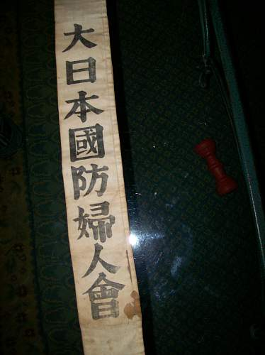 Senninbari (Thousand Stitch Belt)????,  No stiches but Kanji  Help  What is it, and What does it say??