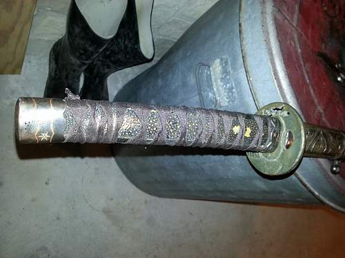 Help with identifying Japanese sword please