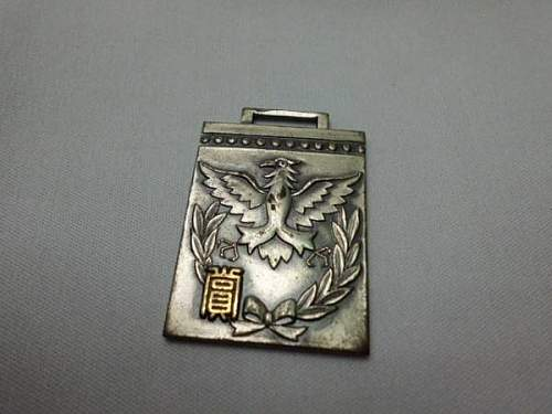 Can anyone help with this Japanese Badge??