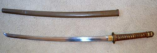 WW2 Japanese sword;need help with identification, please .