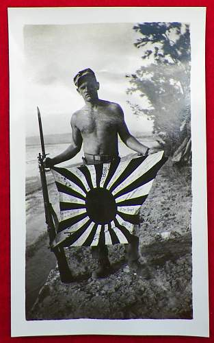Click image for larger version.  Name:WWII - US Marine With Souvenir Battle Flag And Rifle (1).jpg Views:26 Size:132.4 KB ID:703764