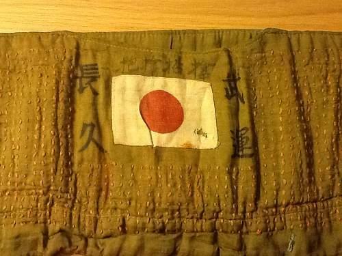 Is this a Senninbari (thousand stitch belt) and can anyone translate the writing?