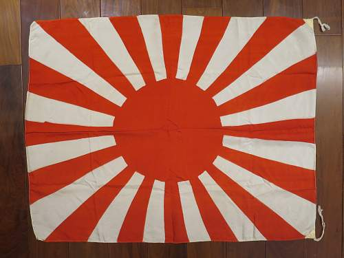 How do you tell if the Japanese flags are from WWII or the repro one? Different corners?