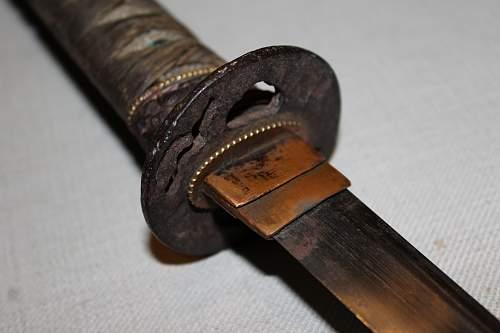 Looking for help identifying sword