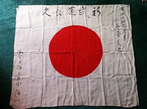 Greetings... New member here, need translation of kanji on a Japanese flag! :)