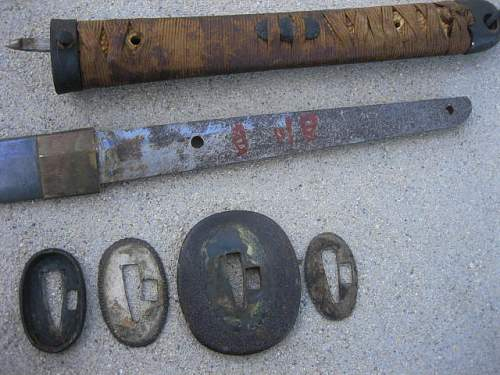 Found 2 WWII Japanese swords..Need help